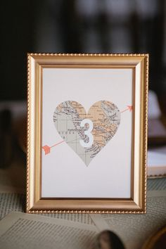 adorable map #tablenumbers - photo by Morgan Trinker - http://ruffledblog.com/peach-and-gold-texas-wedding/