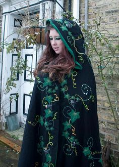 Halloween/Samhain inspired Pagan Ceremonial Cloak with beaded and embroidered embellishments. This cloak is reversable and so can be worn with either the black or the green on the outside. The whole of the black side, including the hood, features a ind.