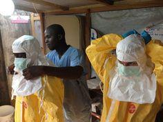 medical-staff-tending-to-the-ebola-virus-outbreak-in-guinea.jpg (680×510)