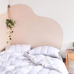 Urban Outfitters Home Now Sells Backdrop Paint - - Urban Outfitters Home dropped a new campaign with paint company Backdrop and the editorial spread features a genius faux headboard hack. Pink Headboard, Faux Headboard, Painted Headboards, Headboard Ideas, Home Bedroom, Bedroom Wall, Bedroom Decor, 50s Bedroom, Bedroom Curtains
