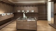 Architectures Ideas Walk In Closet Plan With Square Glass Top Island Table Plus Wooden Cabinets Feat Sectional Clothes Rack 728x400 Pleasant Contemporary House Ideas Design for Perfect Lifestyle