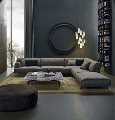 Soggiorno maschile moderno con le pareti grigio scuro, luci particolari e una grande decorazione sul muro.