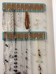 Thick cork board strips for necklace organization.