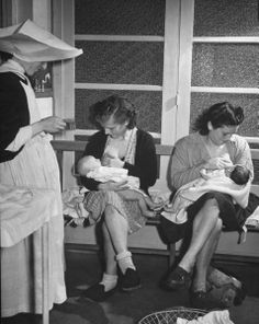 Mothers nursing their babies while waiting their turn to see the doctor, a nun standing nearby.  Location: Paris, France  Photographer: David E. Scherman  Time Life Magazine  Date: Aug 01, 1946