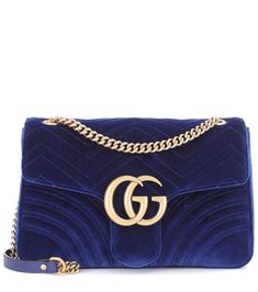 Gucci's GG Marmont Medium shoulder bag has been crafted in Italy from quilted velvet for a chevron finish. The softly structured shape is adorned with the brand's iconic GG hardware for instant recognition – a signature that . Gucci Marmont, Gg Marmont, Gucci Handbags, Handbags On Sale, Gucci Bags, Fashion Bags, Fashion Backpack, Gucci Shoulder Bag, Shoulder Bags