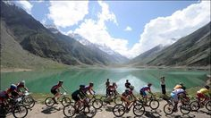 "Foreigners cycling through the lovely Pakistan lake located in Northern Pakistan & known as ""Saif-ul-Malook Lake""! Maldives Family Resorts, Unusual Holidays, Charity Water, Safari Adventure, Cool Countries, Holiday Destinations, Us Travel, Mountain Biking, Beautiful Places"