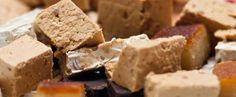 Turrón or nougat is a confection, typically made of honey, sugar, and egg white, with toasted almonds or other nuts, and usually shaped into either a rectangular tablet or a round cake.