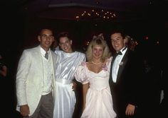 Couples stop dancing to pose for a photo at the 1987 Ring Dance.
