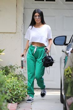 Making them green with envy! Kourtney Kardashian sizzled as she stepped out on a hot summer's day in Los Angeles on Friday
