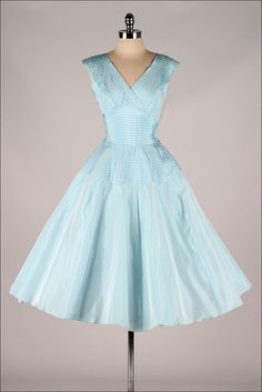 ➳ vintage 1950s dress * powder blue taffeta * pleated bodice * full skirt * muslin skirt lining * metal side zipper * by Fred Perlberg condition | excellent fits like xs length 47 bodice length 18 bust 34 waist 24 hips bodice allowance 2.5 some clothes may be clipped on dress form to show best fit for appropriate size. international customers | this item ships by First Class Mail. Priority available upon request. ➳ shop http://www.etsy.com/shop/millstreetvintage?r...