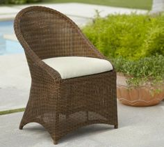 Palmetto All-Weather Wicker Dining Chair (would be great with inset storage cubby)