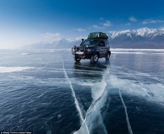 Icy adventure: Alexey Trofimov made the 500-mile journey across Lake Baikal in Siberia in a specially adjusted Suzuki Jimny SUV
