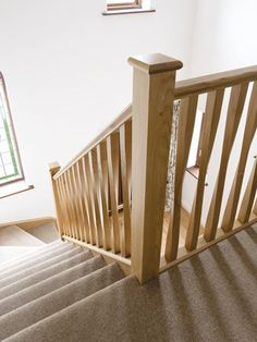 Elegant Staircase Balcony with Wooden Bannister Rails - Neville Johnson