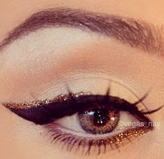 Gold glitter and ink black winged eye liner