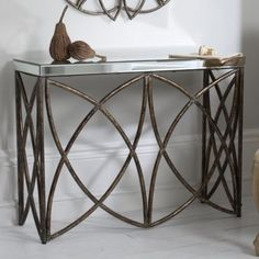 Beckfield Console Table  Striking console table with contrasting mirror top and aged bronze finish.