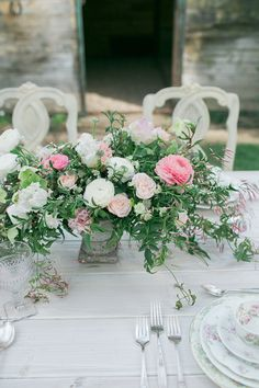 pink and white ranunculus centerpiece