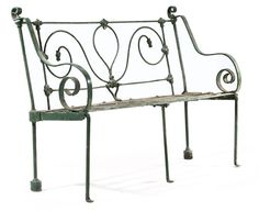 A MID-VICTORIAN WROUGHT-IRON GARDEN BENCH  Circa 1870  The scrolled back with protruding scrolled arms and slatted seat . Christie's.