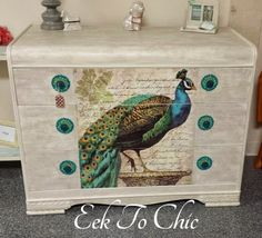 Waterfall Dresser Makeover by Eek To Chic - Decoupaged Peacock Print - Featured On Furniture Flippin' - www.FurnitureFlippin.com