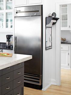 Peter installed a restaurant-grade refrigerator in the kitchen and a freezer in the butler's pantry, each with the capacity of typical residential units, but stripped down of crisper drawers and door shelves. A bonus of commercial refrigeration: an external thermometer for precise temperature control.