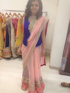 pastelpink saree with an interesting, blue take on the blouse