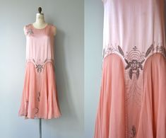 Glorious vintage 1920s rosy pink silk dress with classic 1920s shape, silver floral beading at the shoulder, silver beading around the waist at both front and back, airy chiffon skirt with repeated beading. A treasure to be sure. --- M E A S U R E M E N T S ---  fits like: medium bust: