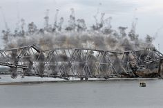 2008.10.06 - A synchronized series of explosives were used to demolish part of the Liberty Memorial Bridge in Bismark, N.D., Monday. (Tom Stromme/The Tribune via Associated Press)