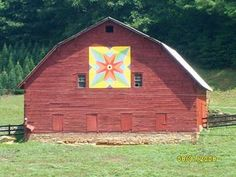 red barn with quilt