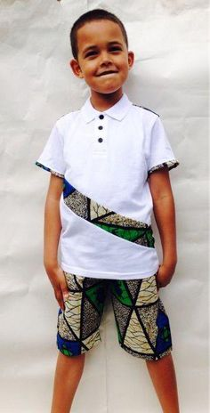 For the boys with their wax. Here is a bright white polo shirt with matching shorts set featuring a multicoloured African wax cotton print. Perfect for special occasions or casual days for boys on the go! Ankara Styles For Kids, African Dresses For Kids, African Children, African Print Dresses, African Fashion Dresses, African Women, African Attire, African Wear, African Style