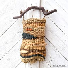 Contemporary Wall Basket with Mushroom and Driftwood Embellishments OOAK. $175,00, via Etsy.