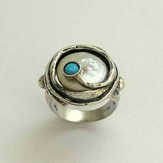Sterling silver engagement  ring with coin pearl and a blue opal - A place under the sun.