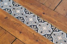 Love this fun tile threshold to transition the wood floors between the kitchen and dining room.  It might be neat if it were the same as the backsplash design over the stove. (outside wood stove dining rooms)