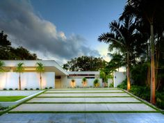 For this bold contemporary driveway in Sarasota, Fla., panels of permeable paving extend the architecture and horizontal grid of the home while allowing water to percolate instead of running off site. The landscaping project by DWY Landscape Architects was a 2014 Florida Chapter of the American Society of Landscape Architects award winner.