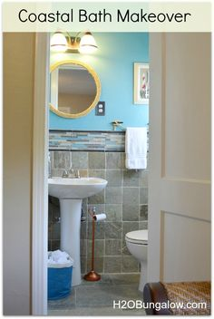 Makeover for a beachy coastal bathroom. Love the colors and simple projects that took this plain bath to fantastic! All projects link to tutorials.