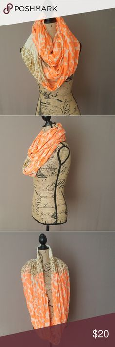 Beautiful Infinity scarf new without tags Infinity Scarf light colored animal print with vibrant orange design. Versatile Scarf measures 34 inches. Accessories Scarves & Wraps
