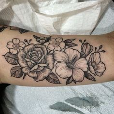 Black and gray Peony, Hawaiian/island flower, and other flower tattoo inspiration... maybe cherry blossoms and a lily. it can work. someone pls draw this out for me.... :(