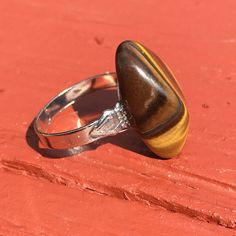 A personal favorite from my Etsy shop https://www.etsy.com/listing/469421537/tiger-eye-silver-plated-adjustable-ring