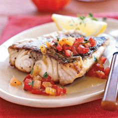 Pan-roasted Sea Bass with Citrus-Heirloom Tomato Vinaigrette Recipe | MyRecipes.com