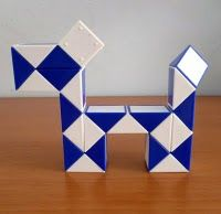 Rubik's Snake - Mine was black & white. Such a simple toy but I spent hours making stuff!