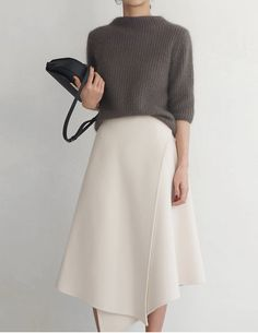 Minimal chic | Grey cashmere sweater, stylish cream fold skirt and a clutch