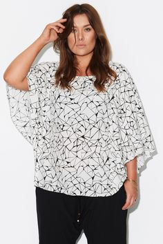 Electric+Love+Blouse+-+Beautiful+floating+sleeve+blouse+with+a+true+to+size+bodice,+featuring+a+key+hole+back+with+fastening,+back+split+detail+for+extra+room+at+the+hem.  Made+from+a+soft+textured+rayon+woven+with+a+slight+crinkle+effect,+for+a+dry+and+breezy+hand+feel.  Repeat+geometric+print,+original+to+17+Sundays,  Wear+it+with+denim+or+a+woven+pant,+can+be+tucked+in+or+worn+out.  Versatile+style+for+the+upcoming+summer+months.  This+garment+is+not+lined.  Our+model+is+weari...
