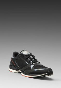 Wanted.. going crazy about sneakers... ADIDAS BY STELLA MCCARTNEY Dorifera Feather Sneaker en Black/Solid Grey/Warning chez Revolve