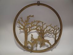 Hey, I found this really awesome Etsy listing at https://www.etsy.com/listing/275123684/vintage-brass-deer-stag-trees-wall-decor
