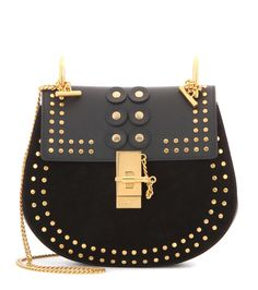Chloé - Drew Small embellished suede and leather shoulder bag - Investing in a Chloé bag is a smart choice, and the 'Drew' silhouette is the ultimate in uncomplicated chic. This ever-chic black suede and leather piece is finished on a glamorous note with gold-tone stud detailing with matching hardware. A true staple accessory to favour for seasons to come. seen @ www.mytheresa.com