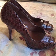 "Steven by Steve Madden Brown Snake Skin heels Never worn!  These are a brown snake skin pattern peep toe platform heel from Steve Madden.  Heel height around 4"" and maybe about 1"" platform. Steven by Steve Madden Shoes Heels"