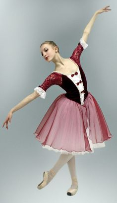 Romantic professional tutu suitable for the role of Raymonda in Variation from Act II. This amazing stage costume features a velvet deep red bodice with a deep white insert and decorative bows. The th