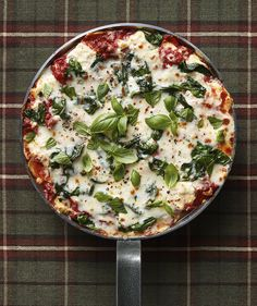 Skillet Spinach Lasagna - Layers of tomato sauce, lasagna noodles, spinach, and ricotta mean tons of flavor in every bite. To serve, cut the dish like a pizza instead of into squares. http://www.realsimple.com/food-recipes/browse-all-recipes/skillet-spinach-lasagna