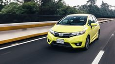 honda-fit-2015-detroit-top-car-auto-show-review-picture-photos-gallery-launch-unveiled-wallpaper-yellow-exterior-drive-in-move-in-motion-road-street
