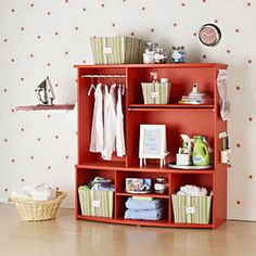 Duh! An old media center turned into a beautiful, functional laundry room organizer....must do!