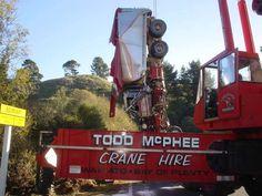 Alpha lifting wrecked truck