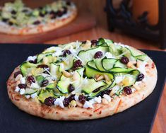 #PizzaWeek is well underway and Sun-Maid has a healthy yet delicious pizza featuring thinly sliced zucchini, feta cheese, and pine nuts.